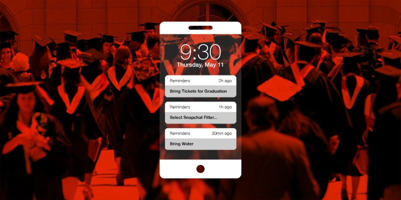 An iPhone with reminders in front of a graduation photo.