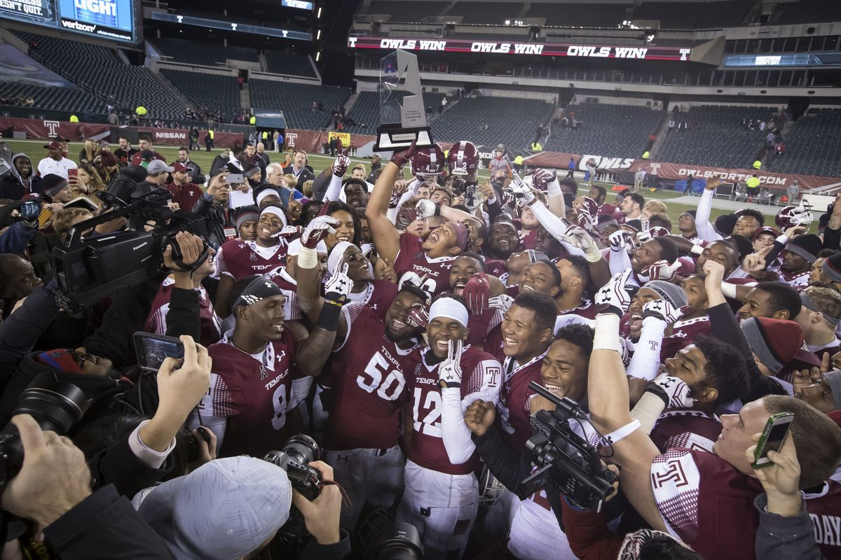 The Temple Football team celebrating a conference championship title in 2016.