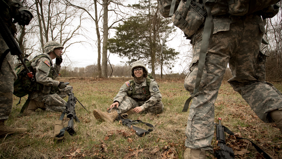 ROTC students in fatigues gathering during a training session at Fort Dix