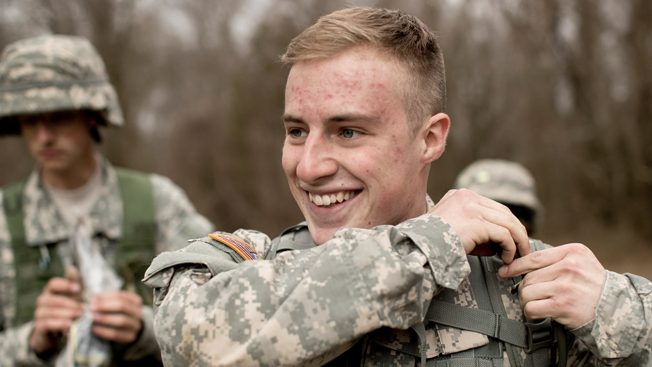 ROTC student in fatigues smiling during training