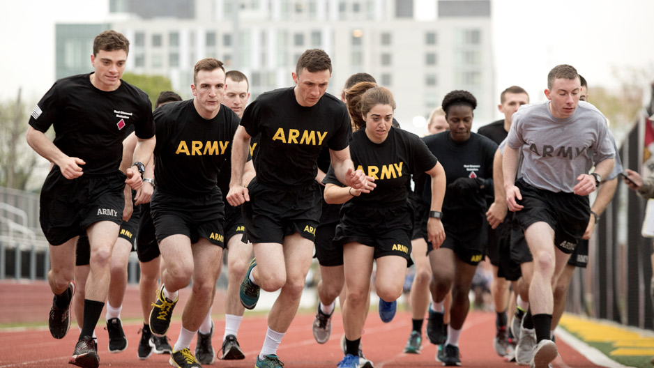 "ROTC students in black ""Army"" T-shirts running together"