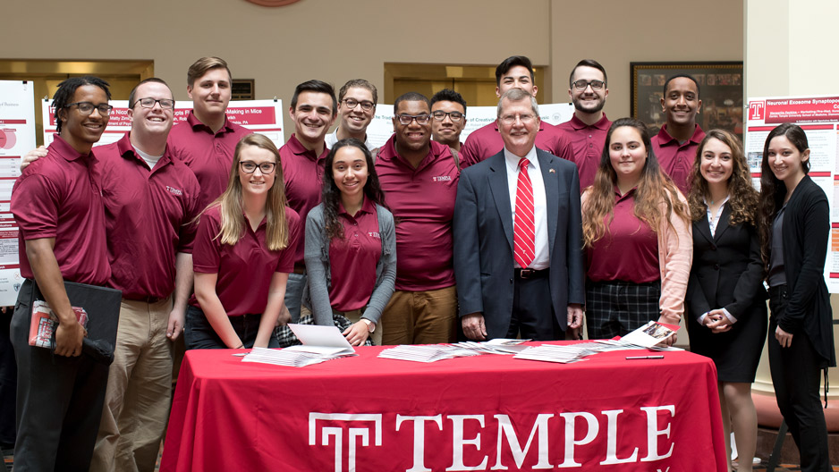 Temple students pose with university President Richard M. Englert in Harrisburg.