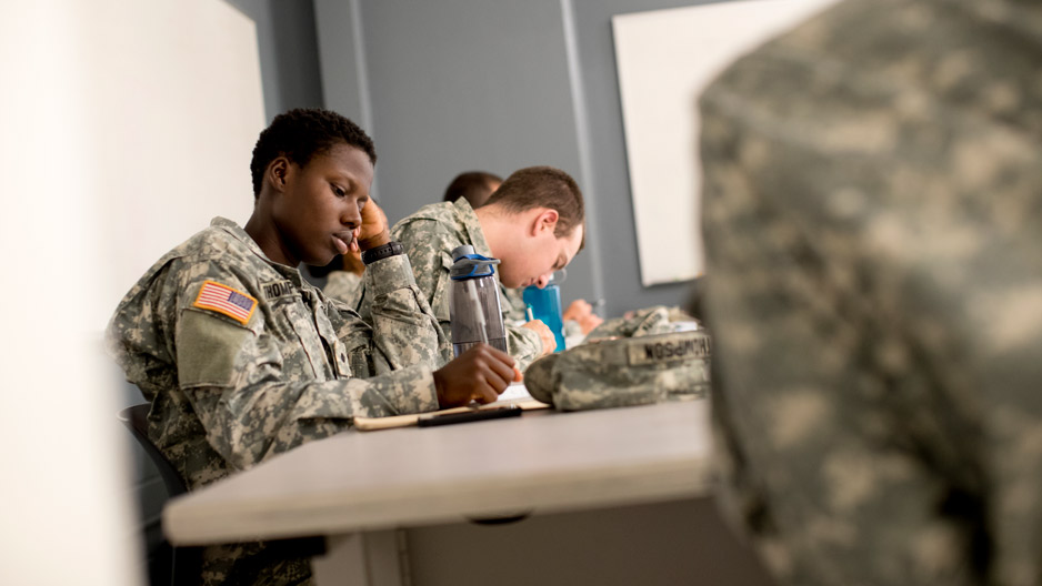 ROTC students in uniform sitting in class
