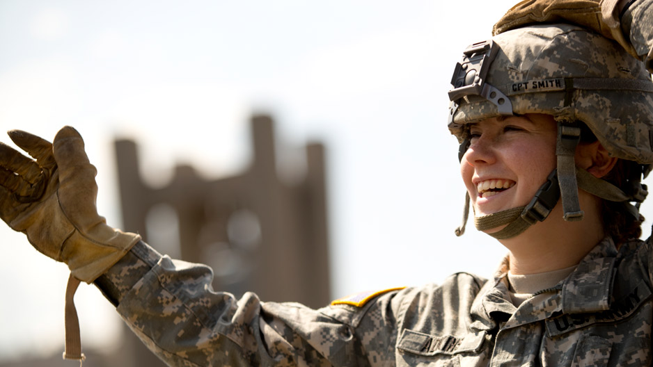 ROTC student smiling while preparing to rappel from a building at Temple