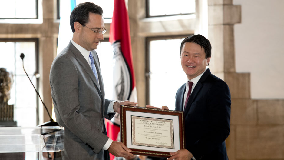 Dean Greg Mandel presents an award to Professor Tom Lin