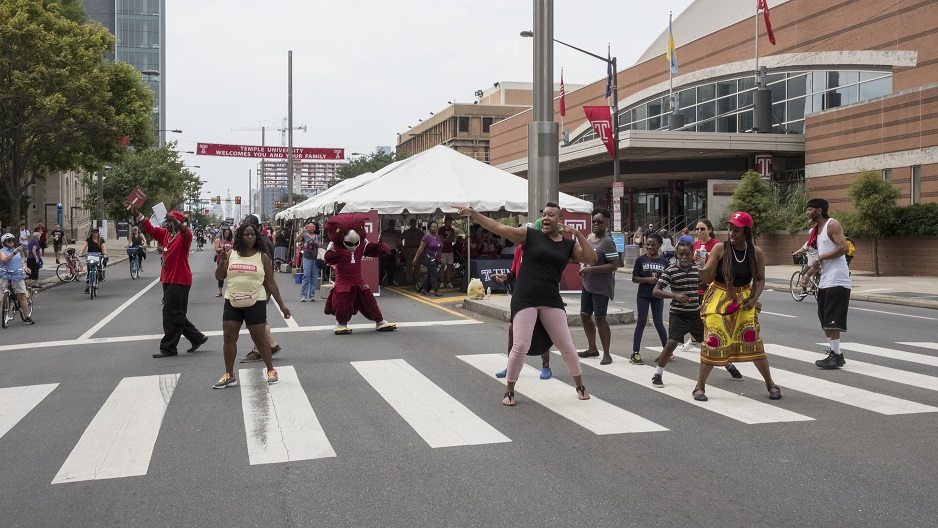 People dancing on North Broad Street as part of Temple's Camp T programming.