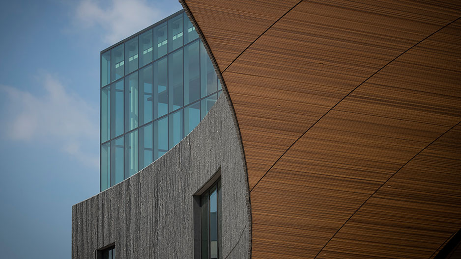 detailing on Charles Library exterior - glass, granite and wood