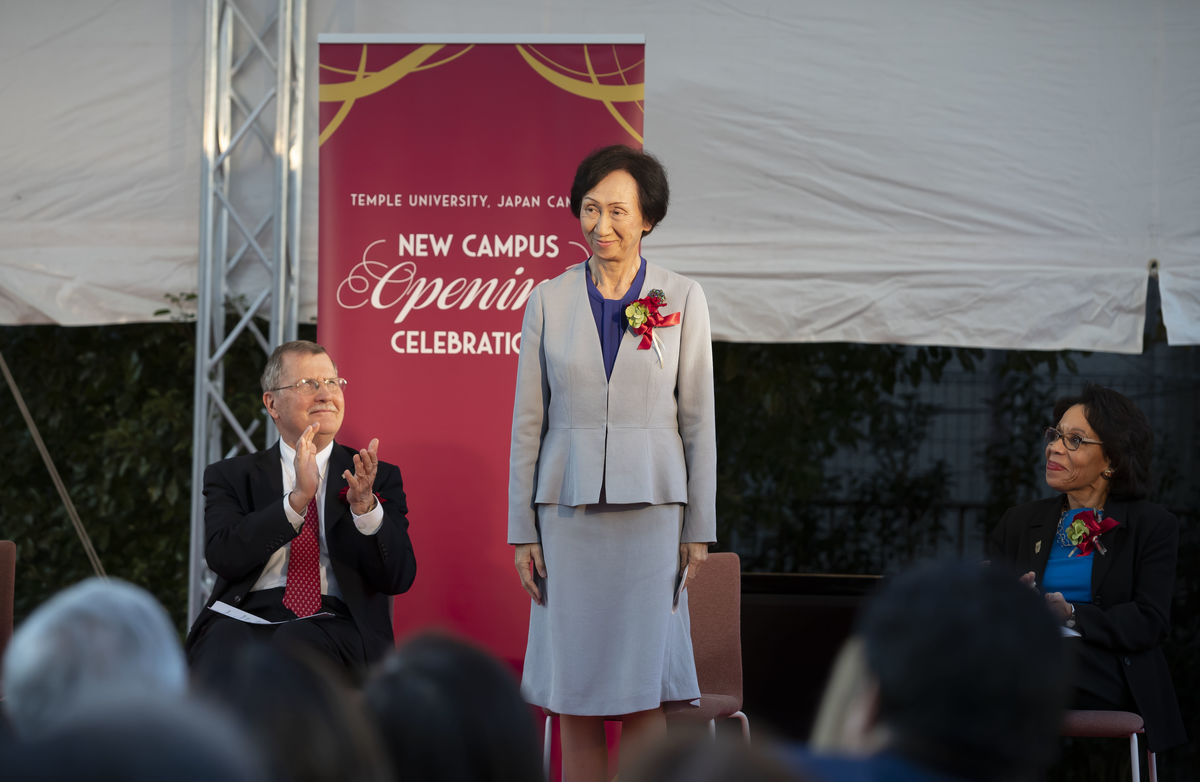 Tomoko Kaneko, president of Showa Women's University stands on stage with Temple University leadership during the grand opening of TUJ's new campus celebrations in Tokyo.