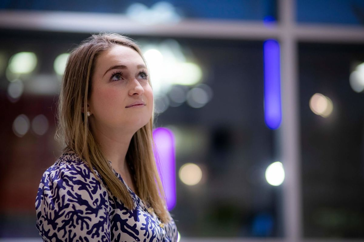 Boyer music therapy student Allie McCrea stands in the lobby of the Tyler School of Art and Architecture.