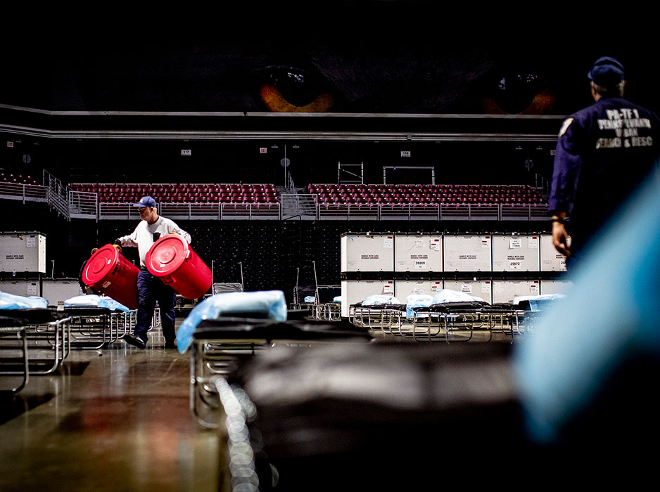 workers bring medical supplies into Liacouras Center