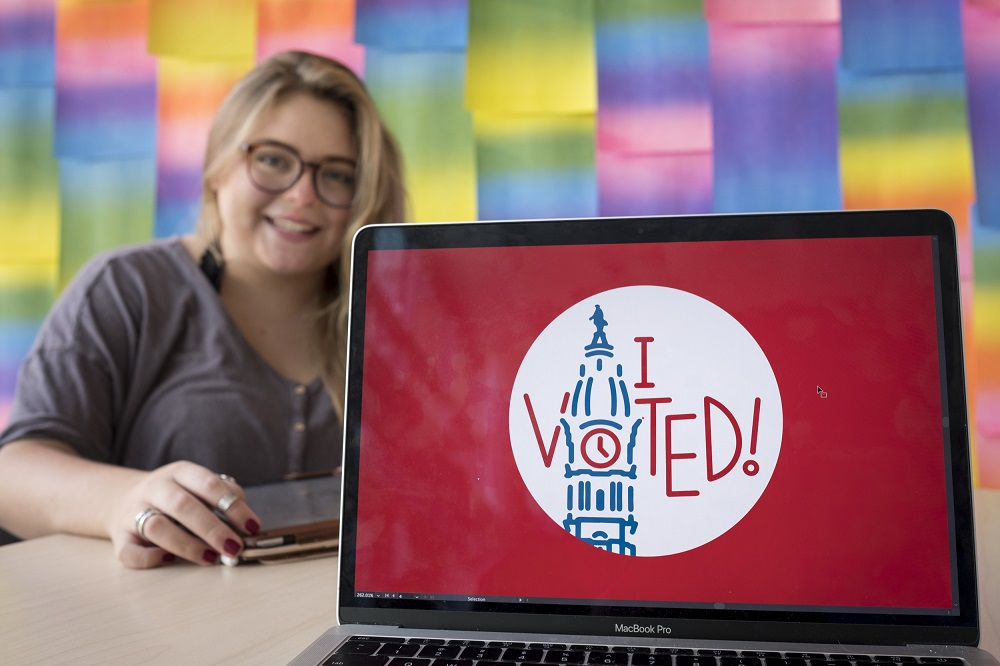 "Student Kate Fish showing her design for the Philadelphia ""I voted"" sticker."
