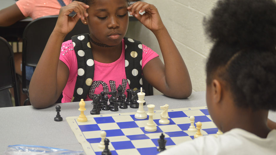 fifth grade camper D'Miyah playing ESF Senior Camp Chess