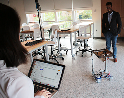 students in lab with autonomous robot