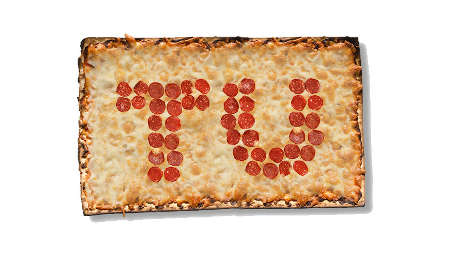 "A square pizza with ""TU"" in pepperoni."