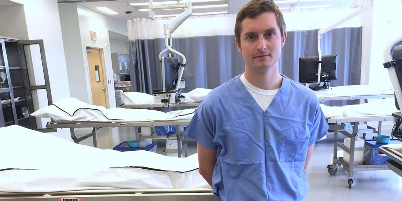 medical student Michael Rockman standing in a lab.