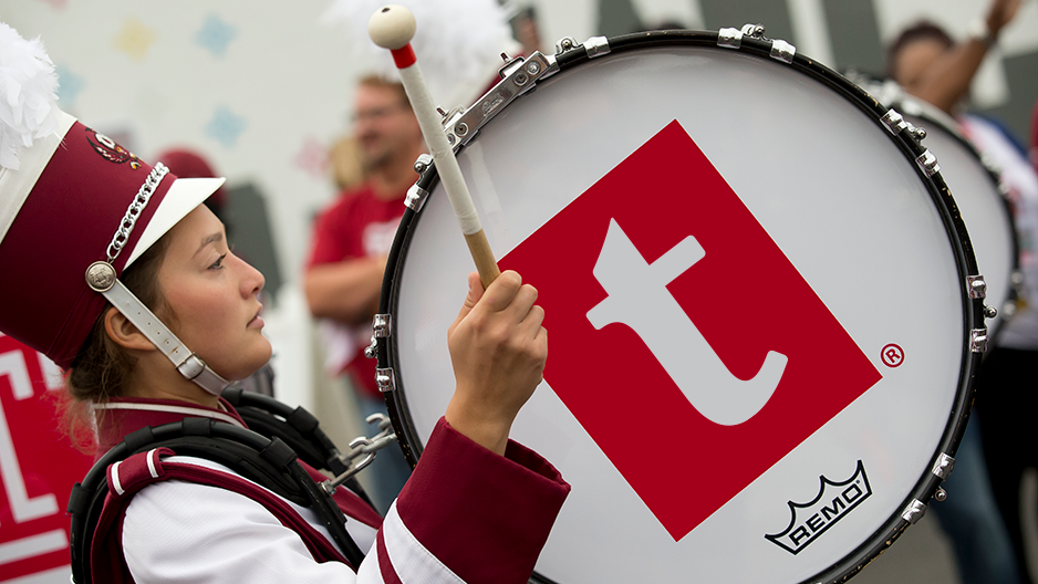 """A drum that shows Temple's updated lowercase """"t"""" logo."""