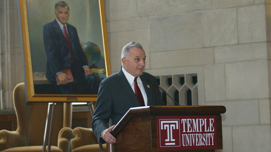Temple's seventh President Peter J. Liacouras standing at a podium.