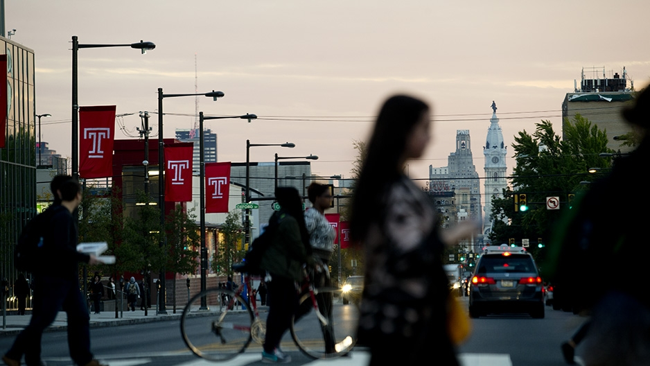 Temple flags on Broad Street with a view of City Hall.