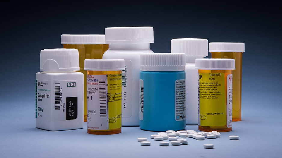 prescription medication bottles and pills.