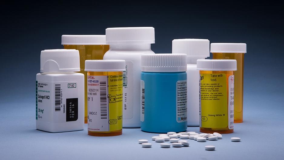 prescription medication bottles and pills.