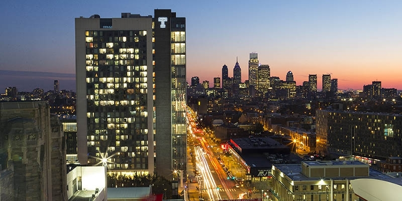 Morgan Hall and the Philadelphia skyline at sunset.