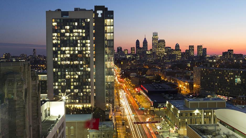 Morgan Hall and the Philadelphia skyline at sunset.