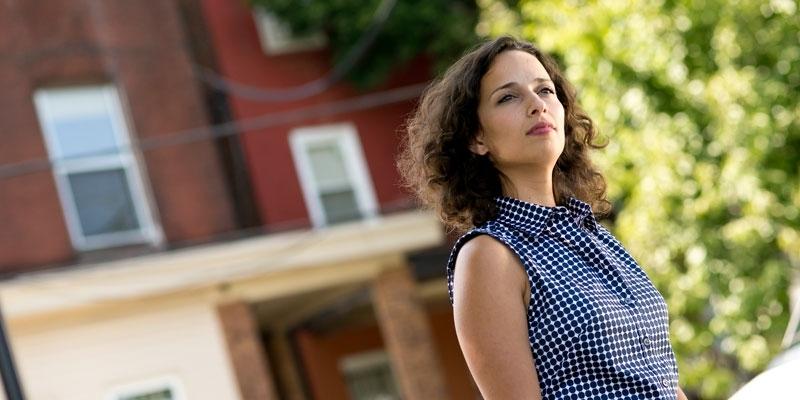 Temple University graduate Yasmine Mustafa standing outside on campus.