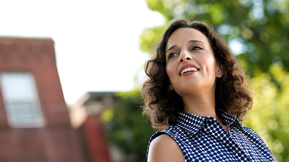 Yasmine Mustafa standing outside smiling.