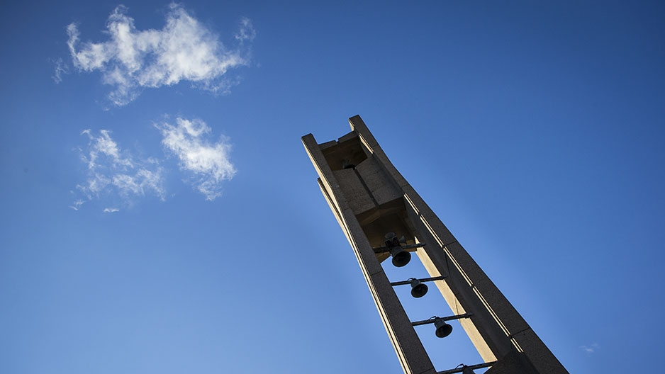 The Bell Tower and a bright blue sky with a few white clouds in the background.