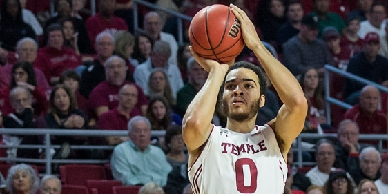 A Temple men's basketball player shooting a three-point shot.