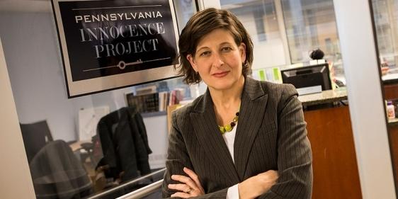 Marissa Bluestine standing in the Pennsylvania Innocence Project's doorway.