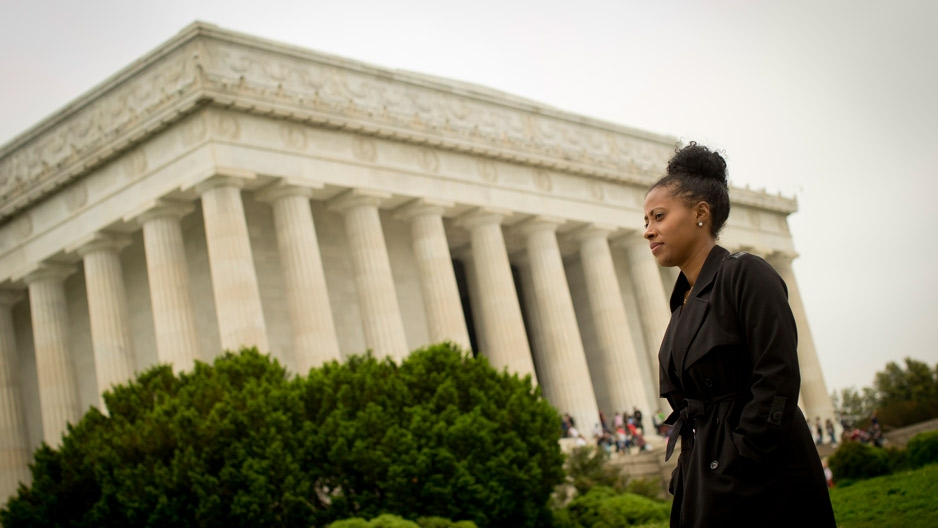 Temple graduate Jamira Burley standing in front of the Lincoln Memorial.