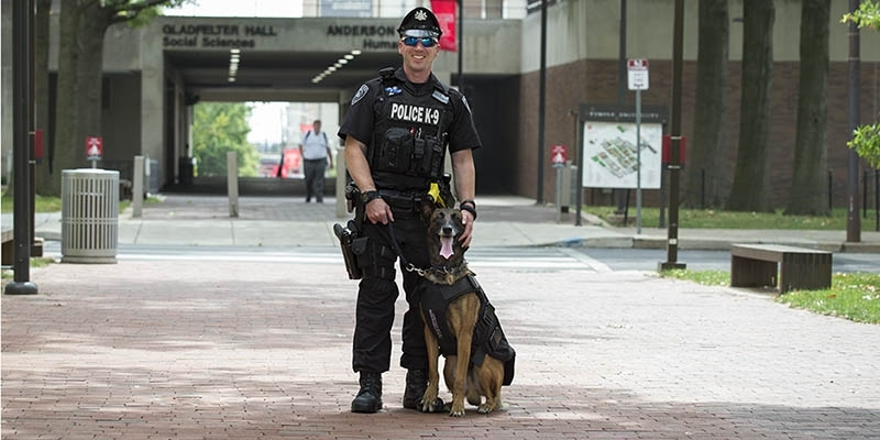 Office Doug Hotchkiss with K-9 officer Baron.
