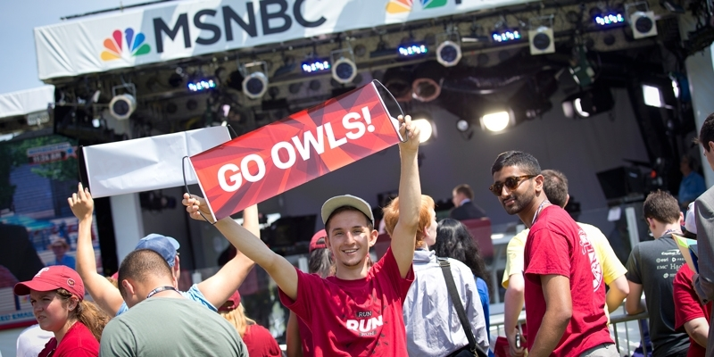 Temple students on an MSNBC set with banners and Temple t-shirts.