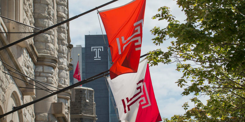 Temple flags flying on campus.