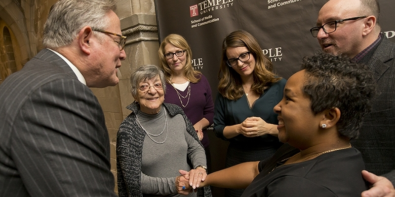 Student Ashley Rodriguez smiling as she meets Tina Fey and others.