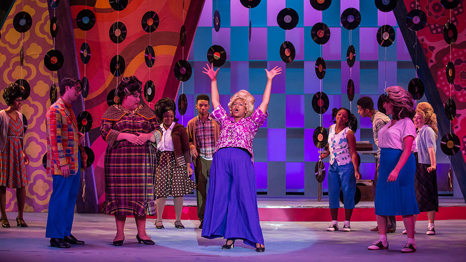 Actors in costume on the set of Temple Theaters's production of Hairspray.