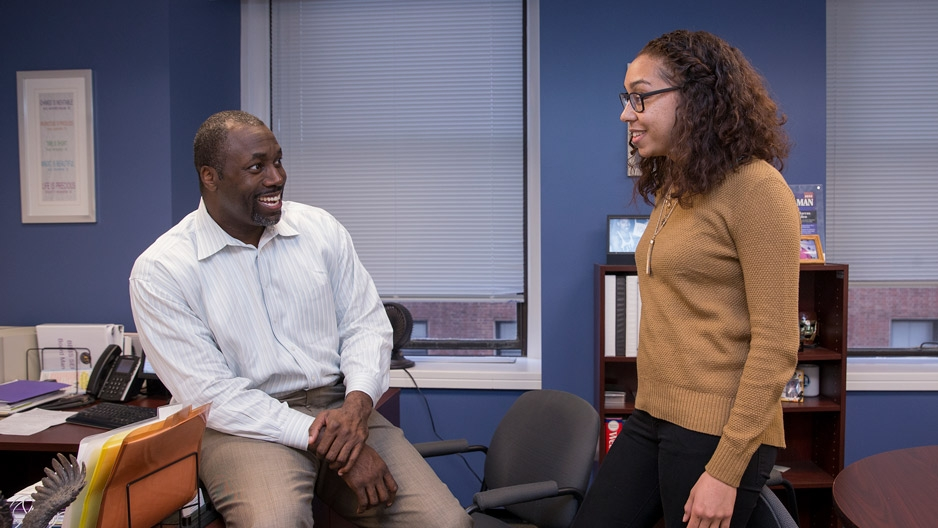 Marcus Allen, CEO of Big Brothers Big Sisters Independence Region, talking to an employee