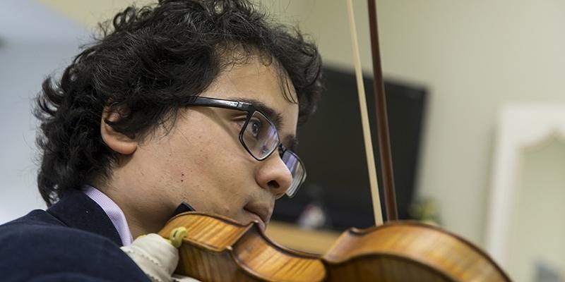 Samuel Nebyu playing the violin.