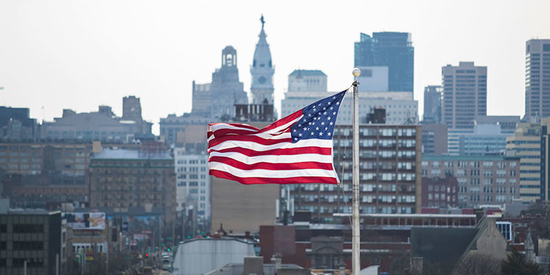 American flag with Philadelphia skyline