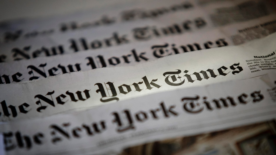 A spread of several New York Times newspapers.