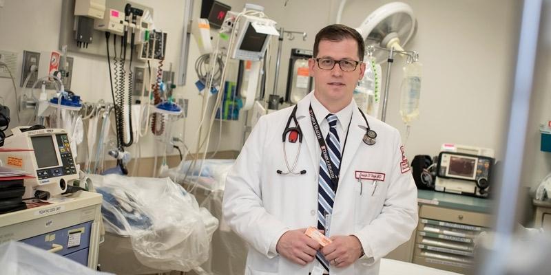 Dr. Joseph D'Orazio holding naloxone in a trauma bay at Temple Hospital.