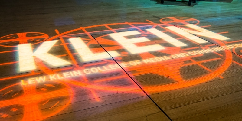 Klein College's logo projected onto a stage