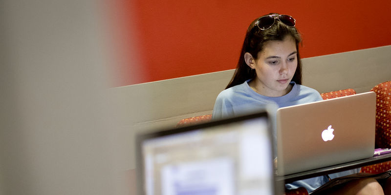 A student using social media at the TECH center