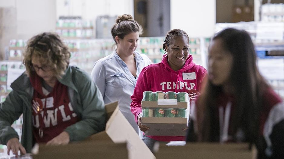 Volunteers working together to package food.