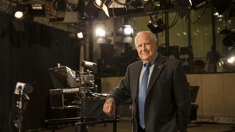Lew Klein standing in a studio near a camera