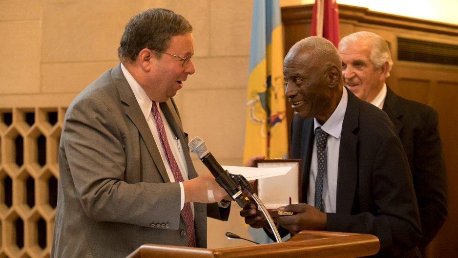 David Cohen presenting historian Charles L. Blockson with the Philadelphia Award