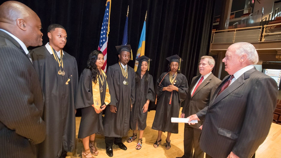 Graduating students and Temple leaders talking at Carver's graduation ceremony.
