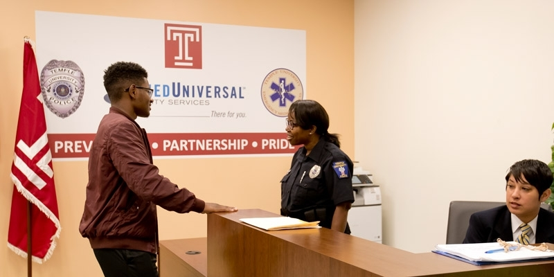 A man talking with a police officer inside the new station