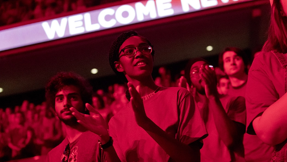 New Temple students clap during a post-Convocation pep rally
